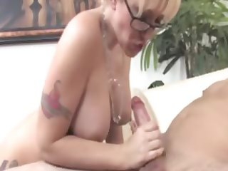 tattood busty older with glasses cleaning out her