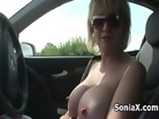 golden-haired mature shows sexy assets outdoor