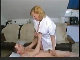 fat golden-haired granny nurse gives her patient