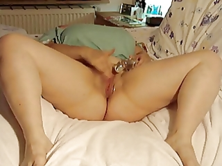 obese older masturbates on bed