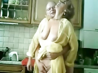 mama and dad having pleasure in the kitchen.