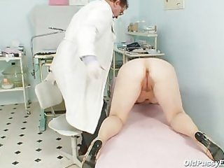 zita aged woman gyno speculum exam at clinic