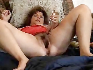 pervert older whore has pleasure with her toys.