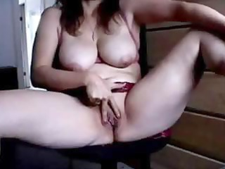 mature playing in front of livecam