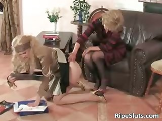 breasty older wench puts thong on fake penis