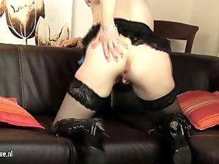 european aged mommy playing with her sex tool on