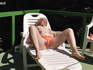 old but still bitch mamma masturbating in the sun