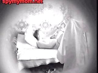 mummy masturbating in bed. hidden cam
