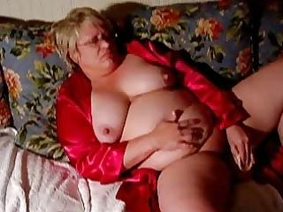 aged big beautiful woman shoves a vibrator inside