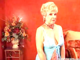mature golden-haired cougar puts on a slow