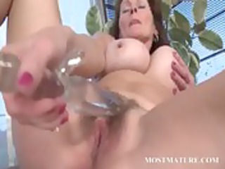 horny aged engulfing and fucking fake penis