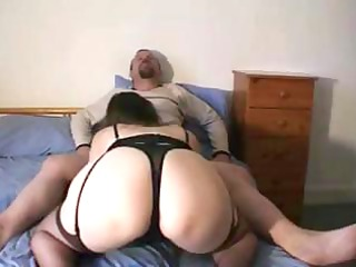 obese brunette hair wife is giving hubby a