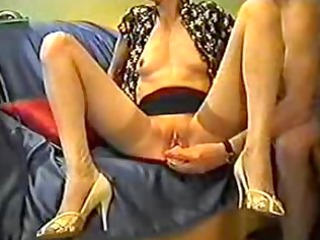 older inserts a sex-toy in her twat