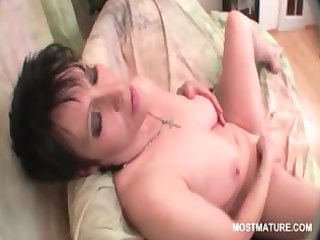 breasty aged brunette stuffing her cum-hole with