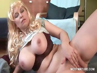lonely busty older copulates herself with fingers
