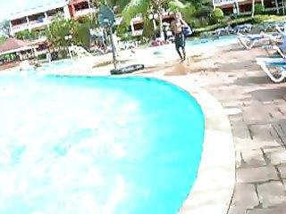 a bushy pits aged woman at a hotel swimming pool
