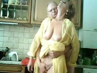 mummy and dad having enjoyment in the kitchen.
