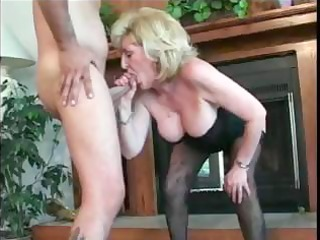 mature older blond lady is engulfing a fucking a