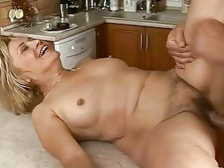 lusty granny acquires drilled hard in the kitchen