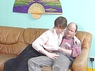 older german widens her legs