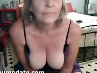 Brunette mature babe with big tits teasing