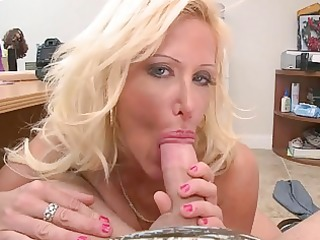 breasty blonde milf shows off her giant melons
