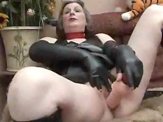 older in fetish wear playing
