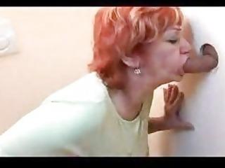 redhead aged gangbanged throughout gloryhole